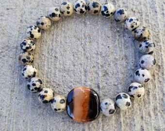 Brown striped Kazuri beaded stretch bracelet dalmatian jasper beads.