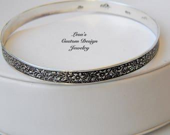 Sterling silver floral pattern bangle bracelet