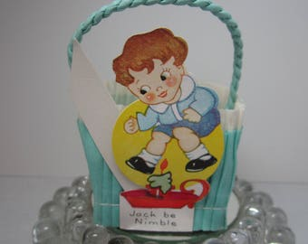 Vintage 1930's blue and white crepe paper nut candy cup party favor basket with die cut image of Jack Be Nimble nursery rhyme character