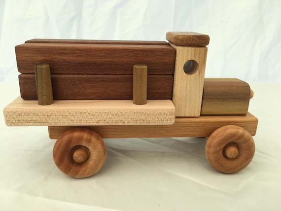 Toy lumber truck with wooden planks
