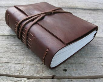"""Leather journal, Les Miserables, """"He never went out without a book under his arm, and he often came back with two"""" / Victor Hugo quote"""