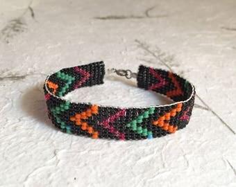 Handmade Black Beaded Bracelet with Green, Magenta, and Orange Chevron Stripes