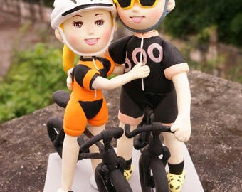 Boo bicycle wedding Cake topper clay doll,Bride and groom in cycling clothing clay miniature, race bikes clay figurine engagement decoration