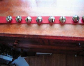 Vintage sleigh bells on red leather hand tied Christmas in July brass bells 8 bells attached