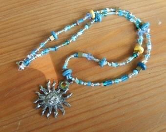 Metal Sun Face Pendant on Handmade Beaded Necklace with Blue and Yellow Random Beads - Women, Girls - Beach, Summer, Sun, Sunshine, Mr. Sun