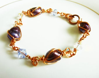 Copper wire wrapped purple pearls and crystal bracelet