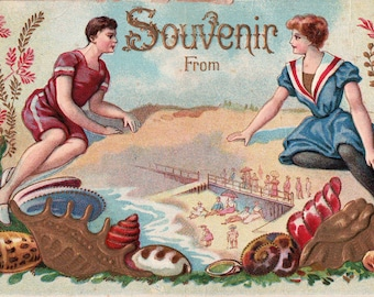 1900's Bathing Beauties Souvenir From postcard - embossed man and woman on beach in bathing suits with seashells