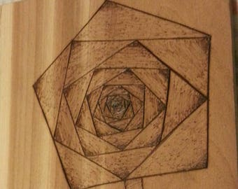 Wood burned rose flower on Cedar
