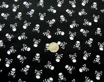 """100% cotton, white pirate skull and crossbones on black, 54"""" wide"""