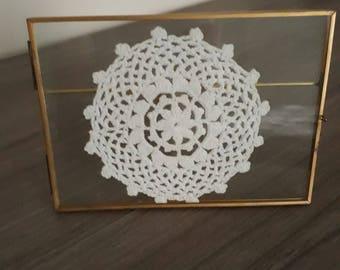 Framed crocheted doily