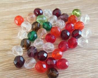 assortment of 40 glass beads
