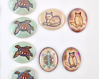 Porcelain cabochon focal, hand painted embossed designs. Sea turtle, spirit turtle, cat and owl in green and brown for bead work, wire work.
