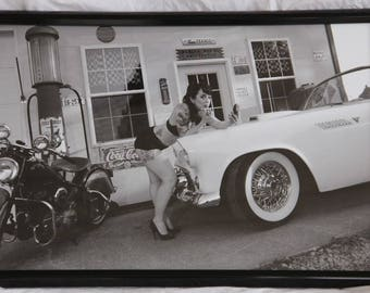 16x24 inch framed poster of a pin-up girl doing make-up on a T-bird