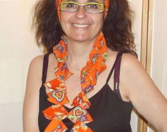 Four in a orange headband