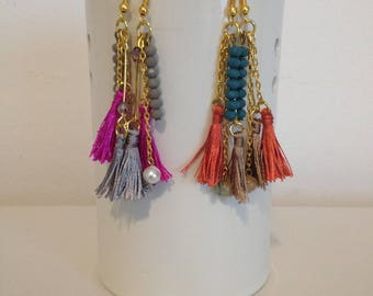 Earrings with two-tone tassels and beads