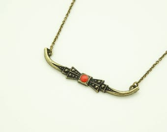 Choker with bow tie orange red enamel charm