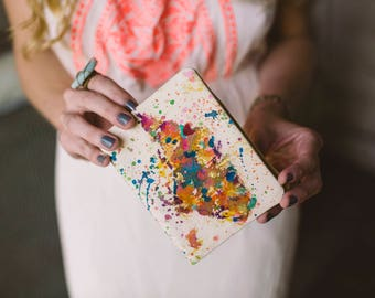 I left my heart in...my heart belongs to...passport cover with colorful splatter map of 1-2 places in the world that are special to you