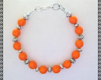 orange bracelet, bright orange bracelet, bright orange, orange, silver bracelet, silver