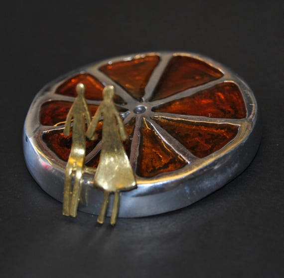 Decoration item, handmade. Aluminum orange and brass couple. The color inside the orange is made of glass.