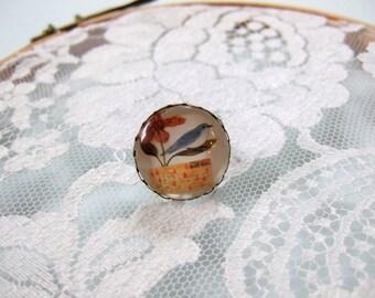 Orange bird and flower round cabochon ring