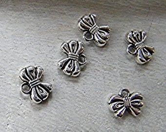 Charm silver metal bow 5