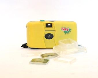 TAKSI plastic analog camera. 1990s