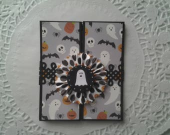 Halloween specialty fold card with decorative band and ghost medallion