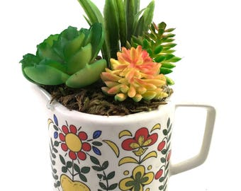 Faux succulent plant floral arrangement in small white vintage creamer with folk art hearts & flowers marked Royal Sealy Japan