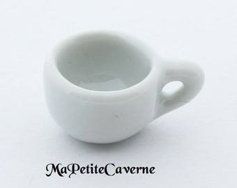 Miniature white porcelain cup