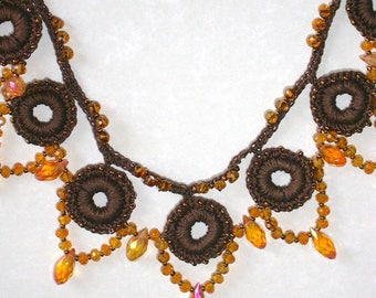 Crochet and beaded necklace Autumn tones of rich brown and topaz create a striking design