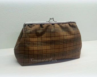Purse with metal clasp and brown print