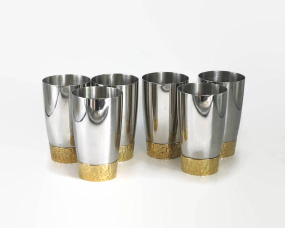 6 water tumblers, Viners by Stuart Devlin, modernist, stainless steel with gilded bases, Sheffield, England, 1970s