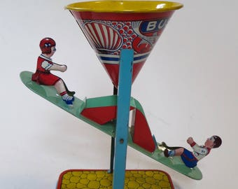 Chein Busy Mike tin litho sand toy
