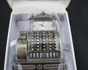 a472 Cash Register Miniature Clock by Timex & Waterbury Clock Co.