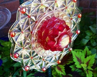 Golden Web with Ruby Center Glass Flower