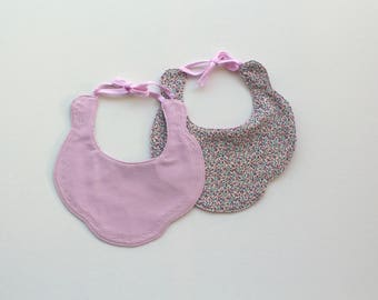 Primrose Pink scalloped bib  A scalloped edge bib just perfect for all occasions in pink on one side & floral print on the reverse