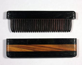 Comb in bog oak case 5400 years old and Madura pomifera