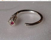 Sale Open shank pinkie ring of .999 pure silver (fine silver) is embedded with a genuine 2mm natural ruby.  The size is 5, and can be adjust