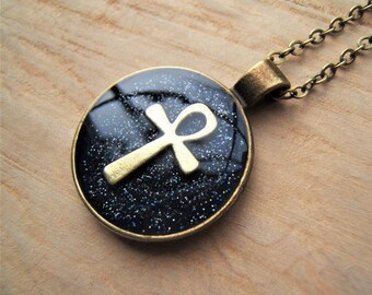 Night sky Ankh necklace. key of life. Ancient Egyptian jewellery. Dark blue background.