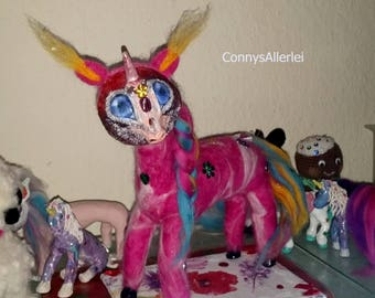Unicorn pink needle felted from fairy wool