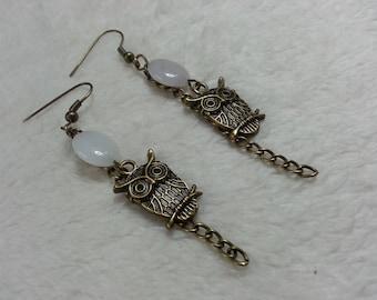 White owls dangling earrings