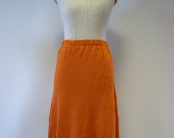 The hot price. Casual knitted orange linen skirt, M size.