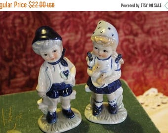 SALE Pair of Porcelain Figurines of Charming Boy with a flower and Girl Chicks Dressed in Blue
