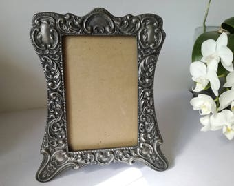 Heavy cast picture frame ,nice condition, not very old i think 1970's