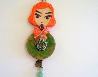 "Decorative figurine orange and green hanging ""Douchka""."