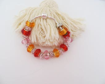 """BRACELET Silver """"snake"""". This are Pinks, reds and oranges slender."""