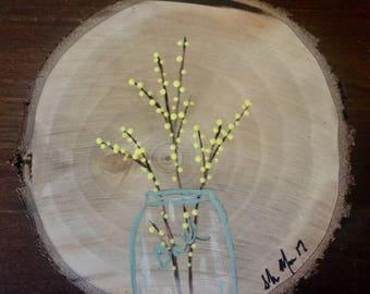Flowers in a Mason Jar on Wood