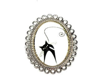 Cabochon black cat on white costume jewelry brooch