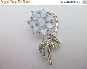 Half off Flower brooch with blue moon glow glass cabochons AA976
