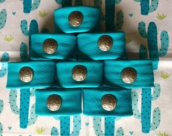 8 Napkin Rings of Turquoise Deerskin Trimmed with an Indian Head Nickel Concho